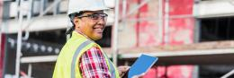 Resources, femal construction work, holding tablet