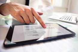 Employers, your premium rate notice is going paperless, person on tablet